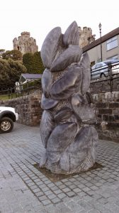The Conwy Mussel Sculpture, created by Greame Mitcheson, stands on the quayside in Conwy, North Wales.