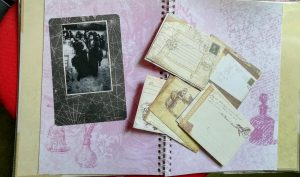 postcards on a scrapbook